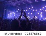 concert goers applauding inside ...   Shutterstock . vector #725376862