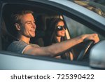 the young couple drive a car | Shutterstock . vector #725390422
