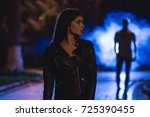 the woman stand on a dark alley ... | Shutterstock . vector #725390455
