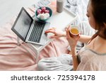 young woman working on laptop... | Shutterstock . vector #725394178