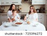 happy family having breakfast... | Shutterstock . vector #725396272