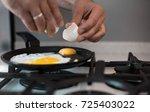a man cook in a beautiful... | Shutterstock . vector #725403022