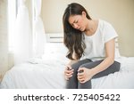 asian woman have a knee ache on ...   Shutterstock . vector #725405422