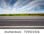 country road with field on... | Shutterstock . vector #725421526