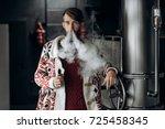 young man with beard vaping an...   Shutterstock . vector #725458345