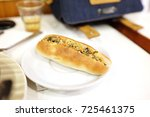vietnamese bread. a baguette is ... | Shutterstock . vector #725461375