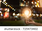 hand holding light bulb in... | Shutterstock . vector #725473402