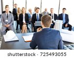 audience of business people and ... | Shutterstock . vector #725493055
