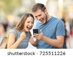 excited couple receiving good... | Shutterstock . vector #725511226