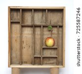 apple in a wooden compartment... | Shutterstock . vector #725587246
