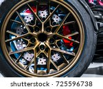 Closeup shot of beautiful stylish alloy wheel of luxury motor supercar or car having large disc brake - stock photo