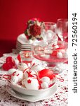 Easter table setting in red tones with candles and flower. - stock photo