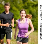 active young couple running in... | Shutterstock . vector #725634745