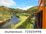 taieri river and the train  ... | Shutterstock . vector #725654998