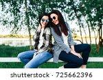 two pretty girls talking... | Shutterstock . vector #725662396