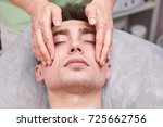 handsome guy  face massage.... | Shutterstock . vector #725662756
