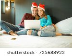 happy couple buying christmas... | Shutterstock . vector #725688922