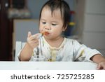 baby asian toddler girl feeding ... | Shutterstock . vector #725725285