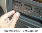 a hand turn on and off of car... | Shutterstock . vector #725730052
