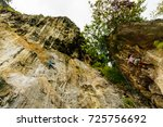 tourist and rock climbers... | Shutterstock . vector #725756692