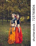 two girls in traditional attire   Shutterstock . vector #725780806