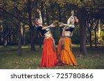 girls perform a dance in nature   Shutterstock . vector #725780866