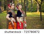 two girls in ethnic costumes   Shutterstock . vector #725780872