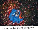 girl in a blue dress. aerial...   Shutterstock . vector #725780896