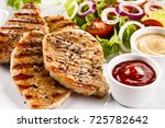 grilled steaks and vegetable... | Shutterstock . vector #725782642