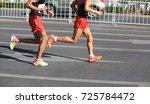 marathon running race | Shutterstock . vector #725784472