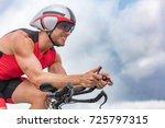 triathlon biking man cyclist... | Shutterstock . vector #725797315