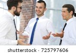 employees are talking  standing ... | Shutterstock . vector #725797606