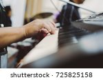 close up hand musician playing... | Shutterstock . vector #725825158