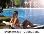 shot of a young woman relaxing... | Shutterstock . vector #725828182