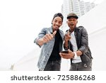 image of cheerful two young... | Shutterstock . vector #725886268