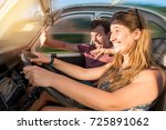 couple in a car at sunset  with ... | Shutterstock . vector #725891062