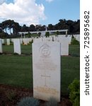 Small photo of ATHENS, GREECE - APRIL 13, 2017: Headstone at the Athens Memorial and Phaleron War Cemetery for Commonwealth serviceman: 2nd lieutenant A.S. Micholls, 4th Queen's Own Hussars Royal Armoured Corps.