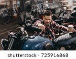 young handsome motorcyclist... | Shutterstock . vector #725916868