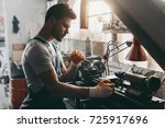 young handsome repairman... | Shutterstock . vector #725917696