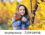 a cute baby girl in an autumn... | Shutterstock . vector #725918938