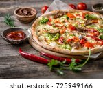 large vegeterian pizza with... | Shutterstock . vector #725949166