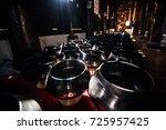 a lot of monk's bowl or alms... | Shutterstock . vector #725957425