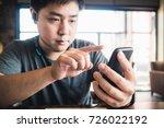 an adorable young asian man... | Shutterstock . vector #726022192