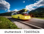 yellow public bus traveling on