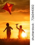 children launch a kite in the... | Shutterstock . vector #726044302