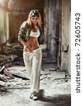 Young woman walking in ruined building. - stock photo