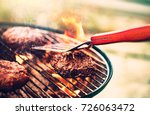 tasty meat on the grill... | Shutterstock . vector #726063472