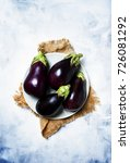fresh purple eggplants on plate.... | Shutterstock . vector #726081292