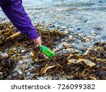 picking up beach rubbish or... | Shutterstock . vector #726099382