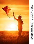 boy launch a kite in the field... | Shutterstock . vector #726140152